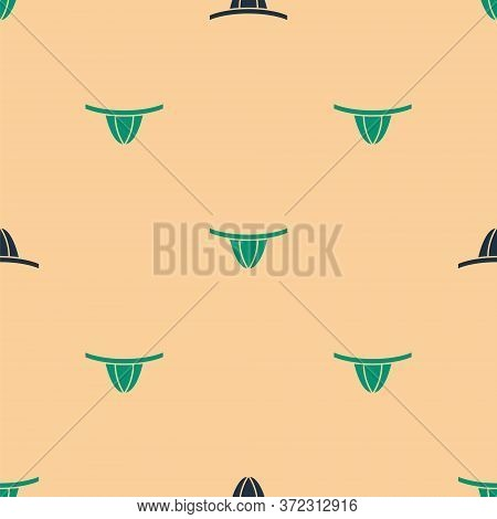 Green And Black Woman Panties Icon Isolated Seamless Pattern On Beige Background. Girls Underpants.
