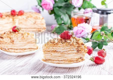 Two Pieces Of Cake Napoleon On White Plate. Russian Cuisine, Multi Layered Cake With Pastry Cream, C