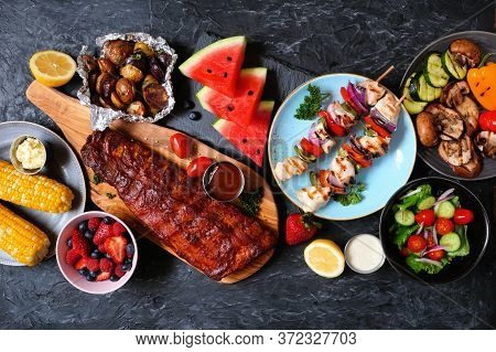Bbq Or Summer Picnic Food Table Scene. Selection Of Grilled Meats, Vegetables, Fruits, Salad And Pot