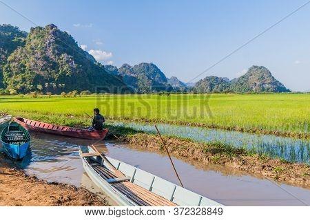 Hpa An, Myanmar - December 13, 2016: Local Woman On A Boat At Lake Near Saddan Cave Near Hpa An, Mya