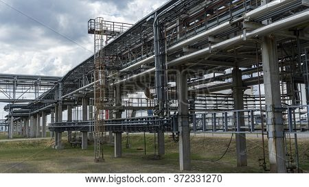 The Equipment Of Oil Refining. Close-up Of Industrial Pipelines Of An Oil-refinery Plant. Detail Of