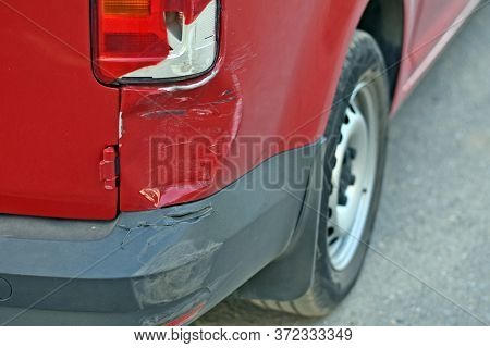 Damage To The Car After An Accident. Dent In The Car And Broken Headlight. Scratches On Car Paint. A