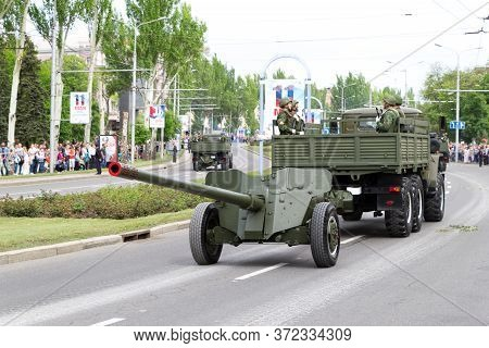 Donetsk, Donetsk Peoples Republic, Ukraine, May 9, 2018. A Convoy Of Military Vehicles With Artiller