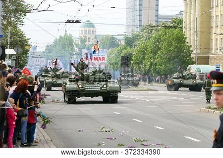 Donetsk, Donetsk Peoples Republic, Ukraine, May 9, 2018. A Column Of Soviet Armored Tanks With Soldi