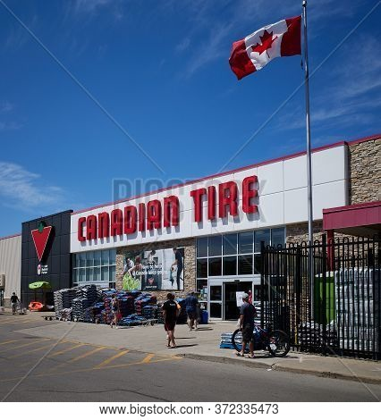 Canadian Flag Flying Outside A Canadian Tire Store Where Canadians Like To Do Much Of Their Shopping