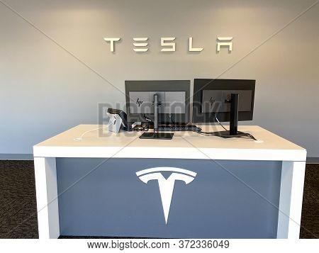Tampa, Fl/usa-5/31/20: The Tesla Sign At The Entrance Of The Tesla Dealership In Tampa, Fl.  Tesla,