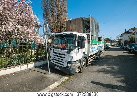 Strasbourg, France - Mar 18, 2020: View Of Scania P320 Truck With Loaded Scaffolding Near An Apartme