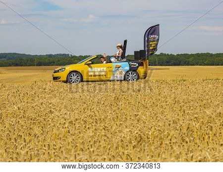 Vendeuvre-sur-barse, France - 6 July, 2017: The Car Of Century 21 Passes Through A Region Of Wheat F