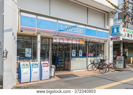 Osaka ,japan - Mar 20, 2017 :  View From Outside Lawson Convenience Store. Lawson Is The Second Larg