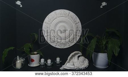 Gypsum Alabaster Round Classical Wall Decoration Rosette, Some Candles, Plants And Sculpture Of Ange