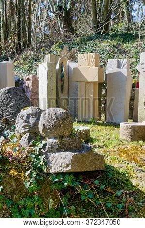 Bern, Switzerland - March 28, 2020: Gravestones, Cemetery Sculptures And Statues Are Displayed Near
