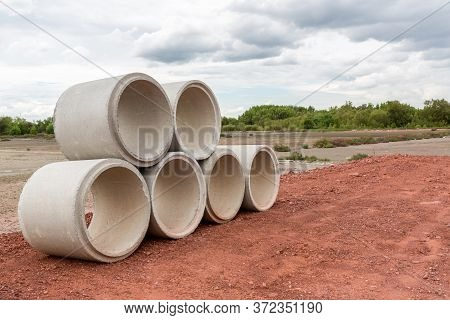 Concrete Drainage Pipe On A Construction Site.  Concrete Drainage Pipes Stacked For Construction. Co