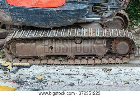 Excavator Tracks. Old Iron Caterpillars Of The Bulldozer Of The Tractor On The Road. Bulldozer Cater