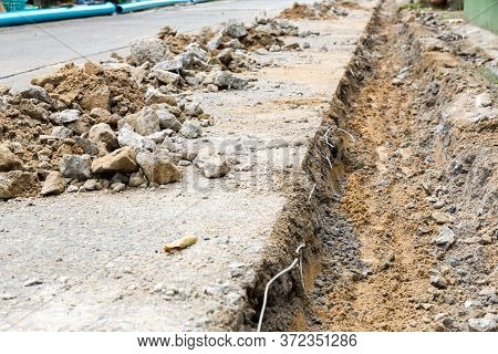 Digging Road Before Install Pipe Water  . Excavation Water Drainage At Construction Site. Digging Ro