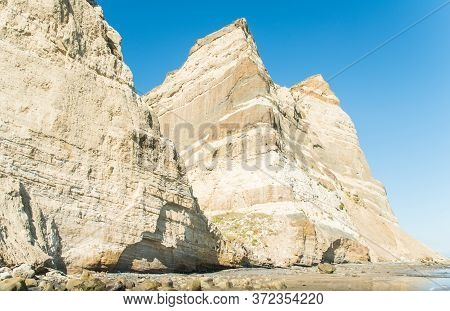 The Spectacular Geological Cliff Formations On The Coast To Cape Kidnappers In Hawke's Bay Region Of