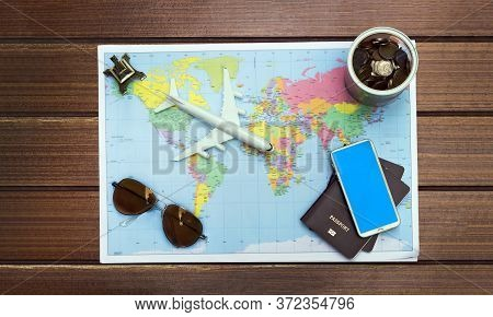 Planing To Travel With Passport And Accessories To The World Map.