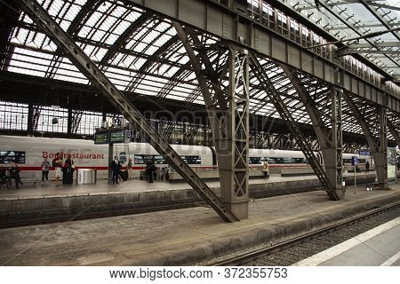 German People And Foreign Travelers Walking Waiting Train In Terminal At Koln Or Kolne Central Haupt