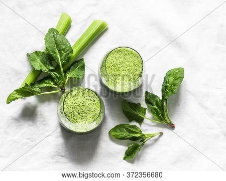Detox Diet Food Vegetarian Concept.  Freshness Celery, Spinach, Natural Orange Juice Green Smoothies