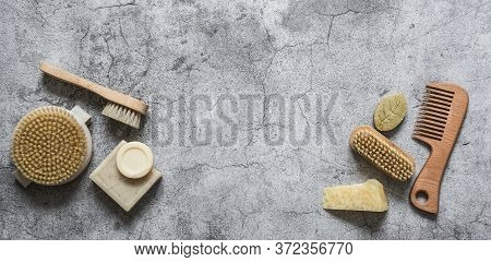 Beauty Body Care Health Background With Copy Space. Natural Brushes, Soap, Pumice On A Gray Backgrou