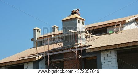 Kyiv, Ukraine - June, 23, 2020:  Roofing Construction: The Roofing Contractor Is Installing Osb Or P