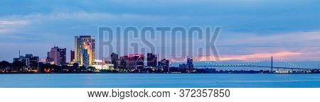 Windsor City In The Canadian Province Of Ontario, Canada, With The Ambassador Bridge On The Backgrou