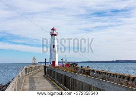 Wawatam Lighthouse In St. Ignace, Michigan, United States Of America, Mackinac Island On The Backgro