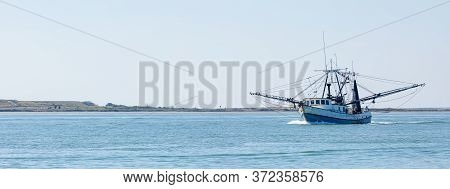 Old Fishing Boat Navigating The Brazos Santiago Pass From The Laguna Madre Into The Gulf Of Mexico
