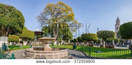 The Plaza De Armas Of Morelia In The Morning, With The Cathedral At The Background, In The Mexican S