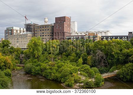 View Down Mississippi River With View Of The Old Mills On The Riverbank, In Minneapolis, Minnesota,
