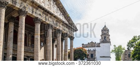 The Degollado Theatre, With The Temple Of San Agustin, In The Mexican City Of Guadalajara, State Of