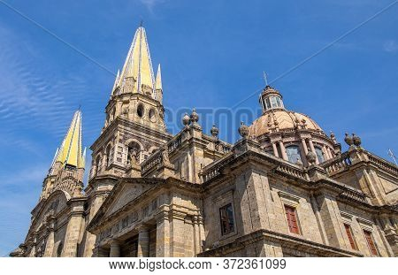 The Guadalajara Cathedral And The Parroquia El Sagrario Metropolitano, Against A Blue Sky, In The Me