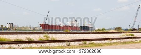 Oil Tanker At Anchor, Infront Of Oil Refinery, Corpus Christi, Texas, Usa