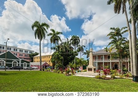 Nassau, Bahamas - May 3, 2019: Street View Of Nassau At Day With People Near The Monument In The Par
