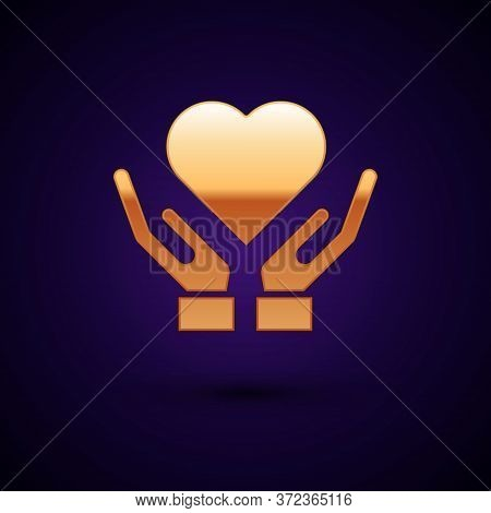 Gold Heart On Hand Icon Isolated On Dark Blue Background. Hand Giving Love Symbol. Valentines Day Sy