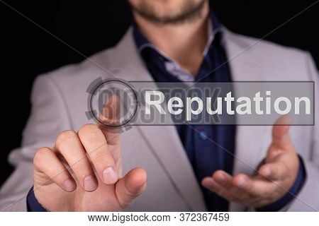 Businessman Presses A Button Finger With The Text Reputation. Business Concept.