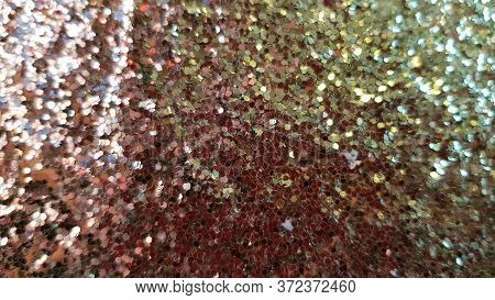 Gold Shiny Blurred Background. Glitter Golden Texture. Bright Brilliance Backdrop. Christmas Glowing