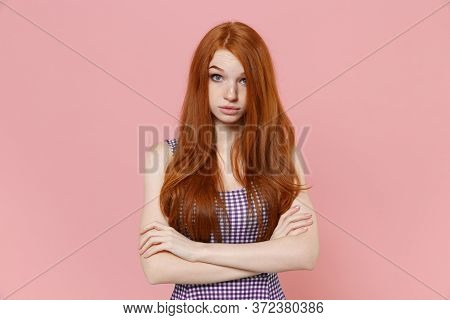 Perplexed Young Redhead Woman Girl In Plaid Dress Posing Isolated On Pastel Pink Wall Background Stu