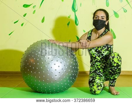 Woman Doing Fitness Exercise, Young Woman On Black Protective Mask Doing Fitness Exercises With Fitn