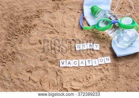 Beach Sand With Toys For The Baby, Water, The Word Holi Stay In Colored Letters