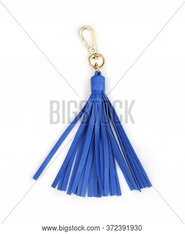 Blue leather tassel isolated on white background for creating graphic concepts