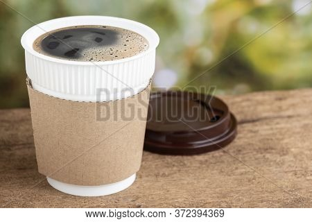 Coffee Cup Or Disposable Cup On The Wooden Table Background On Natural Morning With Copy Space For Y