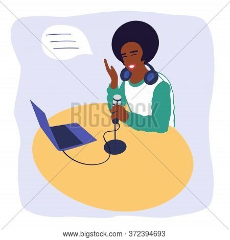Black Man Radio Host Broadcasts In The Media Or Records A Podcast.a Man Is Sitting At A Table With A