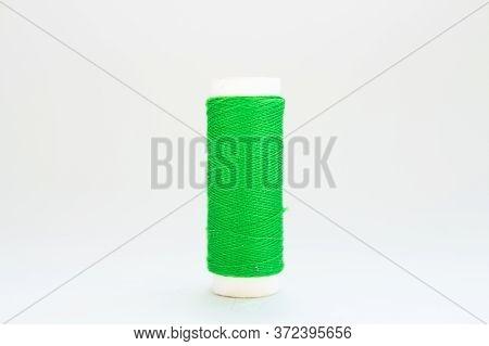 Skein Of Green Thread On White Background