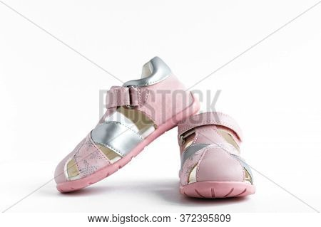 Isolated Children's Pink Summer Sandals On A White Background