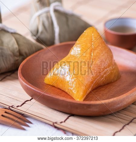 Zongzi - Alkaline Rice Dumpling - Traditional Sweet Chinese Crystal Food On A Plate To Eat For Drago