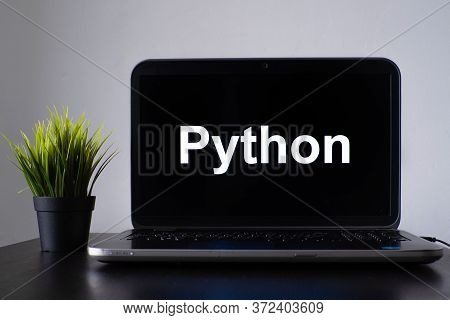 Python Programming Language. Programming Training, The Concept Of Computer Courses. Laptop On The Ta