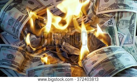 A Lot Of Dollars In The Fire, The Global Financial Crisis And Inflation, The Concept. Lots Of Burnin