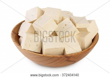 Heap Of Diced Tofu Cheese In Wooden Bowl Isolated On White Background With Clipping Path And Full De