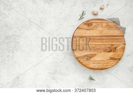 Empty Wooden Round Board On White Stone Kitchen Table, Top View, Flat Lay. Wooden Pizza Platter, Cop