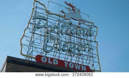 Famous Portland Oregon Old Town Sign - Portland, Oregon - April 16, 2017